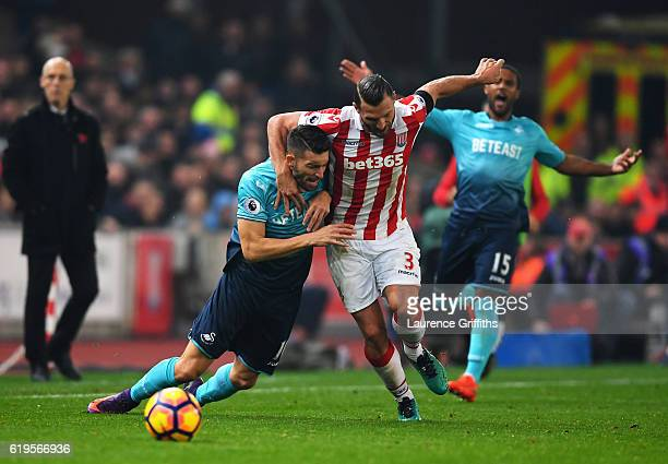 Borja Gonzalez of Swansea City tangles with Erik Pieters of Stoke City during the Premier League match between Stoke City and Swansea City at Bet365...