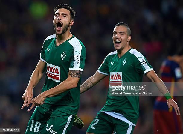 Borja Gonzalez Tomas 'Baston' of Eibar celebrates scoring his team's first goal with Simone Verdi during the La Liga match between FC Barcelona and...