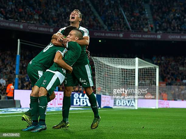 Borja Gonzalez Tomas 'Baston' of Eibar celebrates scoring his team's first goal with Simone Verdi and Gonzalo Escalante during the La Liga match...