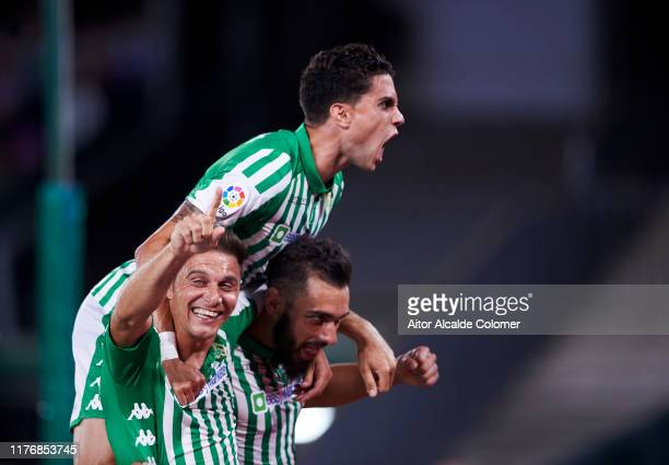 Borja Iglesias of Real Betis Balompie celebrates with his teammates Joaquin Sanchez and Marc Bartra of Real Betis Balompie after scoring his team's...