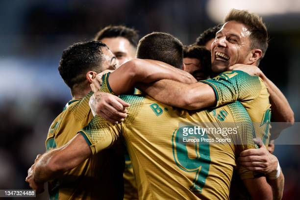 Borja Iglesias of Real Betis celebrates a goal with teammates during the spanish league, LaLiga, football match between Deportivo Alaves and Real...