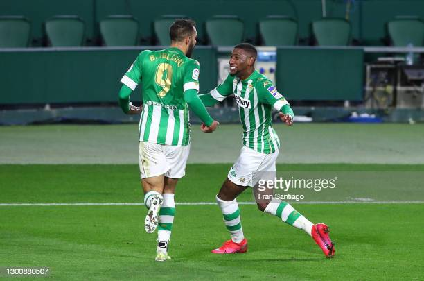 Borja Iglesias of Real Betis celebrates with team mate Emerson Royal after scoring their side's first goal during the La Liga Santander match between...
