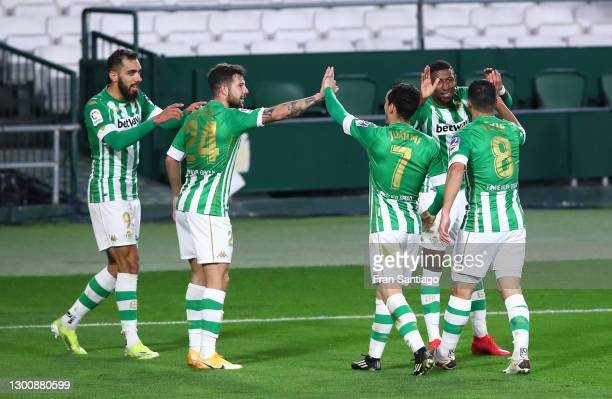 Borja Iglesias of Real Betis celebrates with team mates Aitor Ruibal, Juanmi, Nabil Fekir and Emerson Royal after scoring their side's first goal...