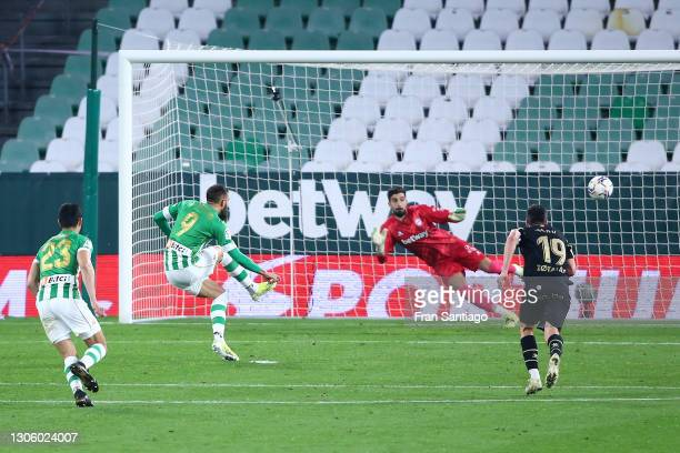 Borja Iglesias of Real Betis scores their side's first goal past Fernando Pacheco Flores of Deportivo Alaves from the penalty spot during the La Liga...