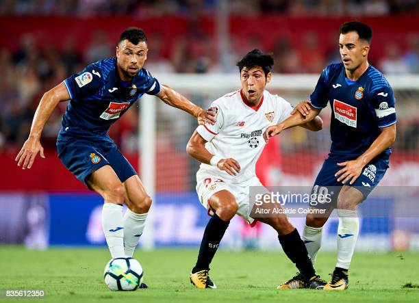 Borja Lasso of Sevilla FC competes for the ball with Javi Fuego of RCD Espanyol and Jose Manuel Jurado of RCD Espanyol during the La Liga match...