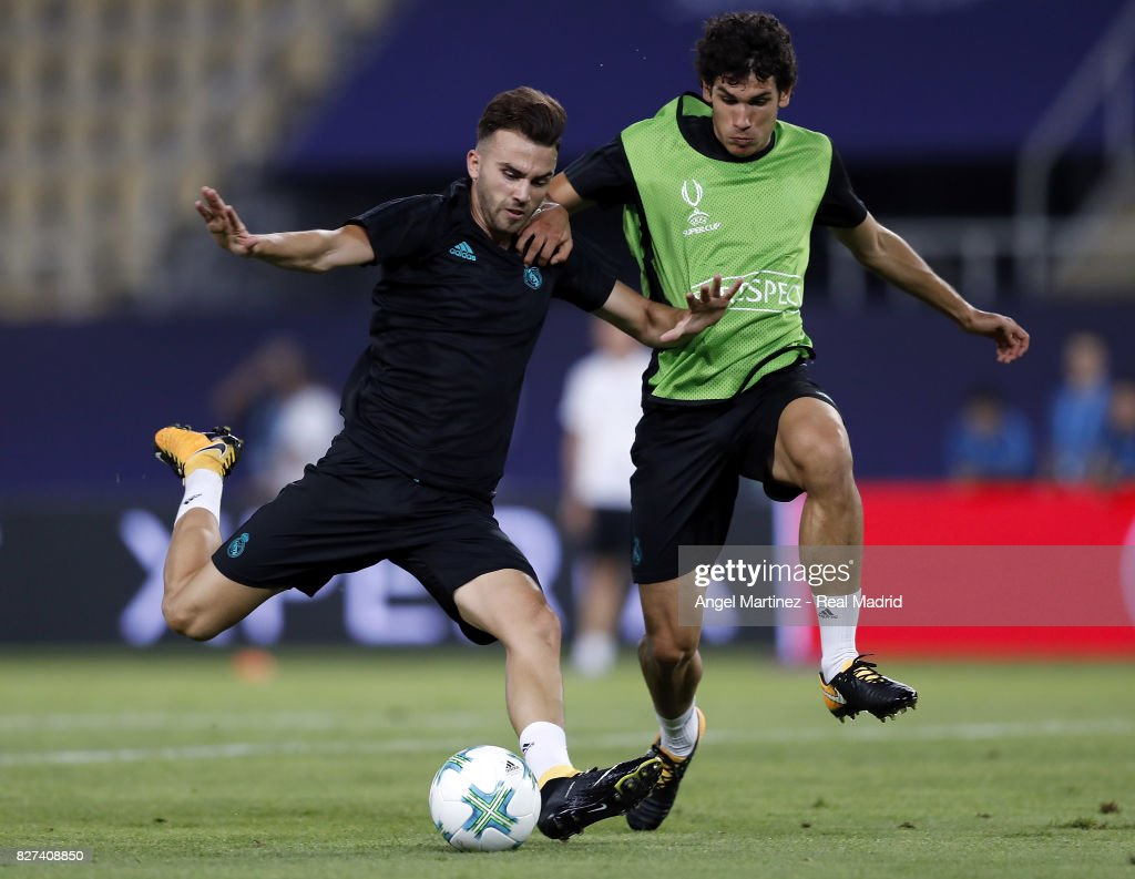 Borja Mayoral (L) and Jesus Vallejo of Real Madrid in action during a training session at Philip II Arena on August 7, 2017 in Skopje, Macedonia.