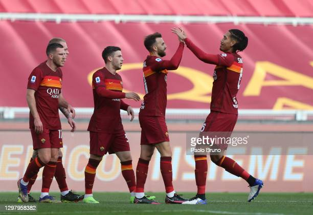 Borja Mayoral of A.S Roma celebrates with teammate Chris Smalling after scoring his team's first goal during the Serie A match between AS Roma and...
