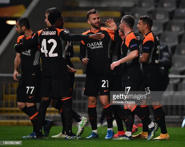 Borja Mayoral of AS Roma celebrates with teammates, high fiving Jordan Veretout after scoring their team's second goal during the UEFA Europa League...