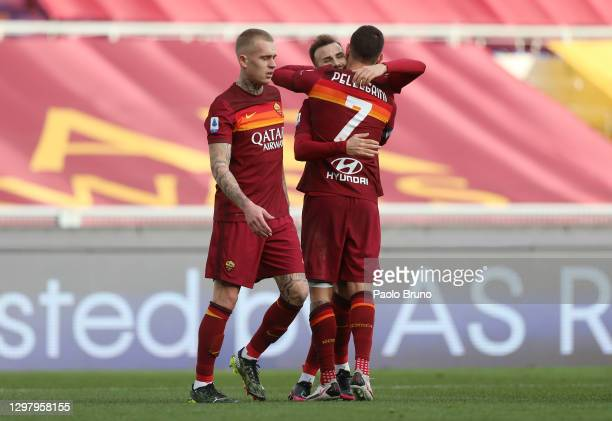 Borja Mayoral of A.S Roma celebrates with teammates Rick Karsdorp and Lorenzo Pellegrini after scoring his team's first goal during the Serie A match...