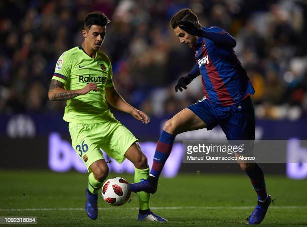 Borja Mayoral of Levante UD competes for the ball with Juan Brandariz Chumi of FC Barcelona during the Copa del Rey Round of 16 first leg match...