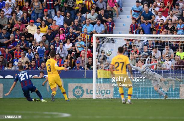 Borja Mayoral of Levante UD scores his team's second goal past Marc-Andre ter Stegen of FC Barcelona during the Liga match between Levante UD and FC...