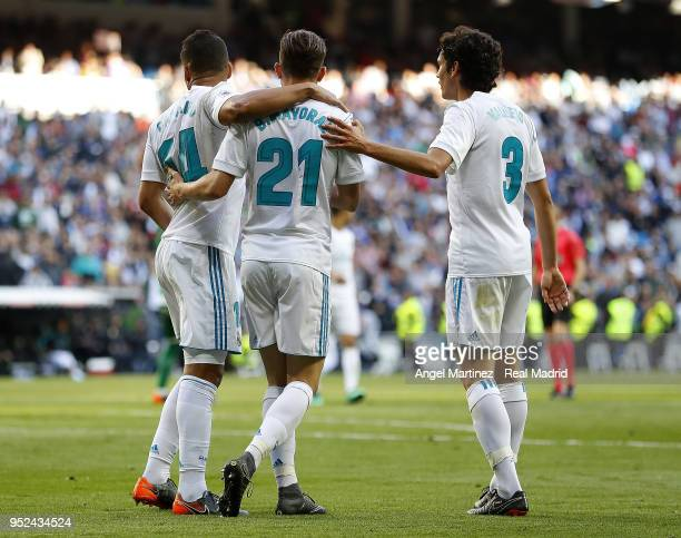 Borja Mayoral of Real Madrid celebrates with Casemiro and Jesus Vallejo after scoring their team's second goal during the La Liga match between Real...