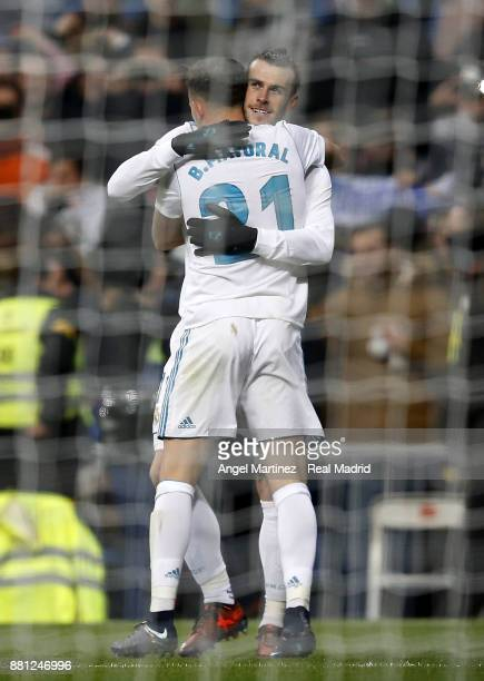 Borja Mayoral of Real Madrid celebrates with Gareth Bale after scoring their team's second goal during the Copa del Rey round of 32 second leg match...