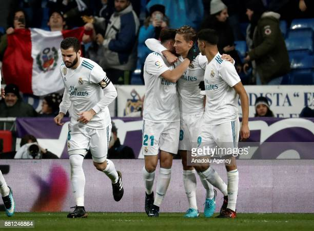 Borja Mayoral of Real Madrid celebrates with his teammates Marcos Llorente Nacho Fernandez and Achraf Hakimi after scoring a goal during the King's...