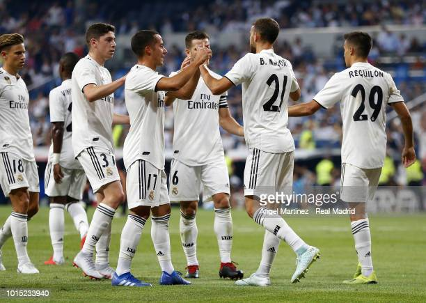 Borja Mayoral of Real Madrid celebrates with team mates after scoring their team's third goal during the Trofeo Santiago Bernabeu match between Real...