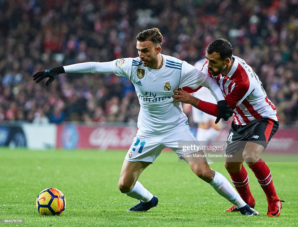 Borja Mayoral of Real Madrid CF (L) being followed by Mikel Balenziaga of Athletic Club (R) during the La Liga match between Athletic Club and Real Madrid at Estadio de San Mames on December 2, 2017 in Bilbao, Spain.