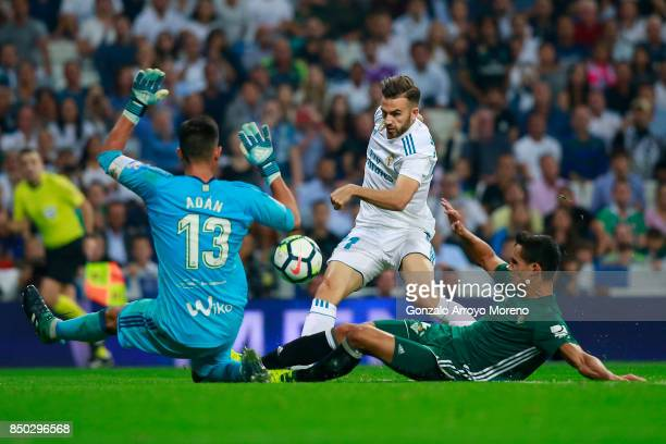 Borja Mayoral of Real Madrid CF strikes the ball behind goalkeeper Antonio Adan of Real Betis Balompie during the La Liga match between Real Madrid...