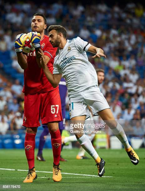 Borja Mayoral of Real Madrid competes for the ball with Marco Sportiello of Fiorentina during the Trofeo Santiago Bernabeu match between Real Madrid...