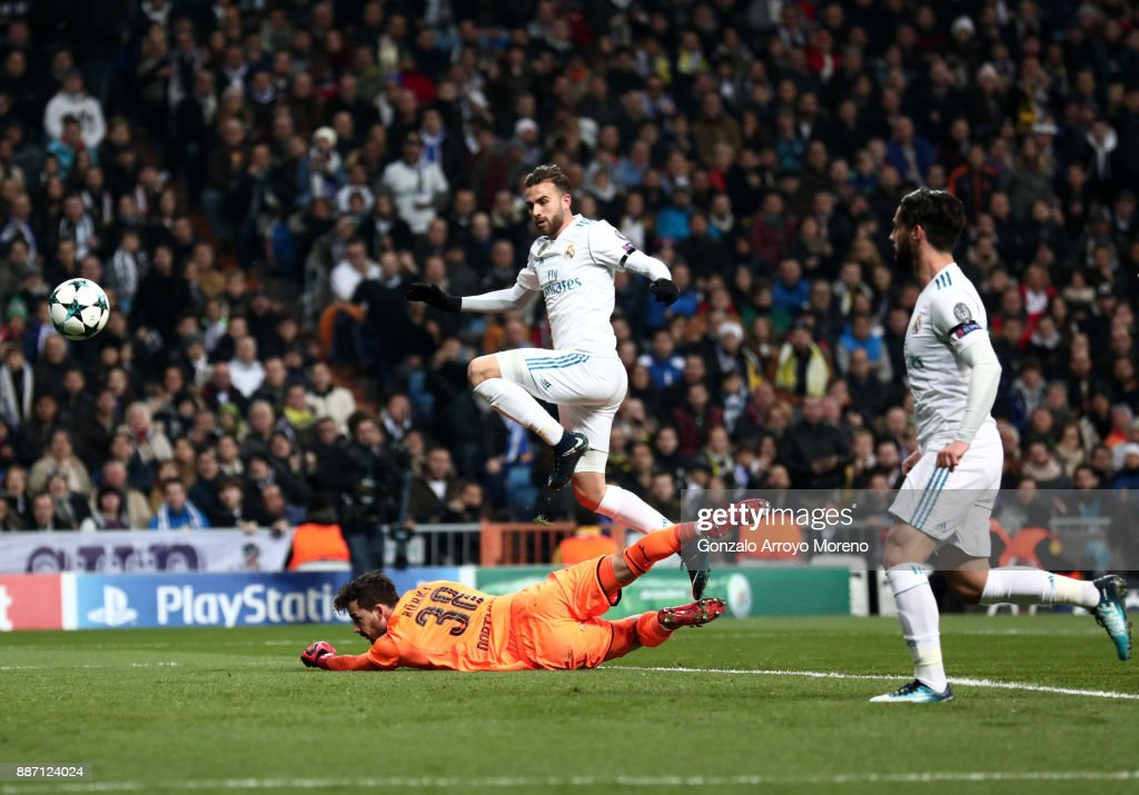 Borja Mayoral of Real Madrid scores his sides first goal past Roman Buerki of Borussia Dortmund during the UEFA Champions League group H match between Real Madrid and Borussia Dortmund at Estadio Santiago Bernabeu on December 6, 2017 in Madrid, Spain.