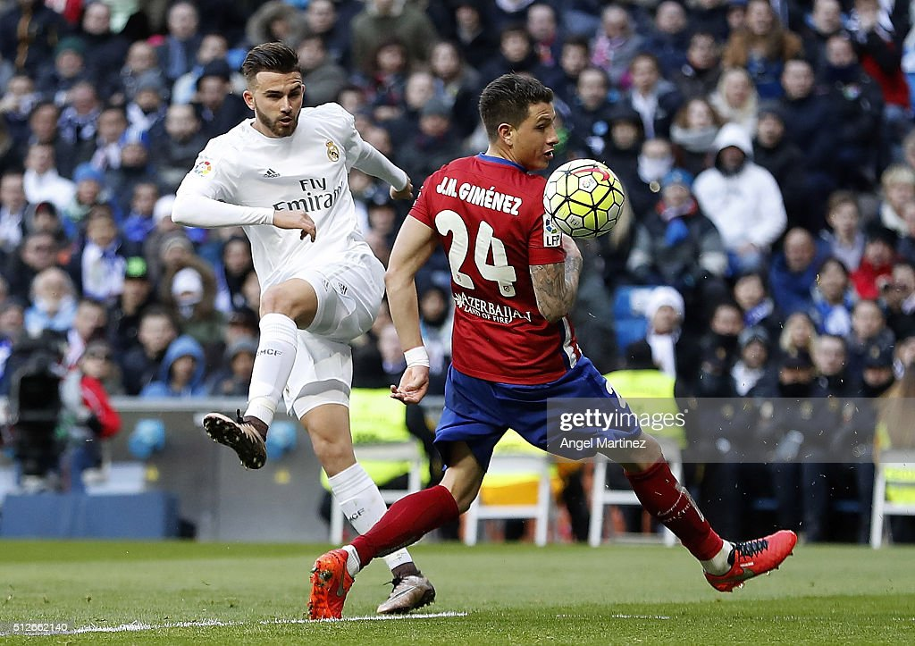 Borja Mayoral of Real Madrid shoots on goal past Jose Maria Gimenez of Club Atletico de Madrid during the La Liga match between Real Madrid CF and Club Atletico de Madrid at Estadio Santiago Bernabeu on February 27, 2016 in Madrid, Spain.