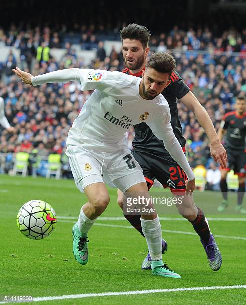 Borja Mayoral of Real Madrid tries to hold on to the ball while being challenged by Carles Planas of Celta Vigo during the La Liga match between Real...