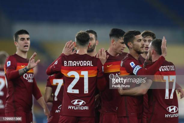 Borja Mayoral of Roma celebrates with Lorenzo Pellegrini and team mates after scoring their side's third goal during the Serie A match between AS...