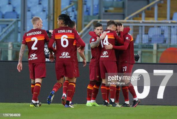Borja Mayoral of Roma celebrates with teammates Gonzalo Villar and Carles Perez after scoring their team's second goal during the Serie A match...
