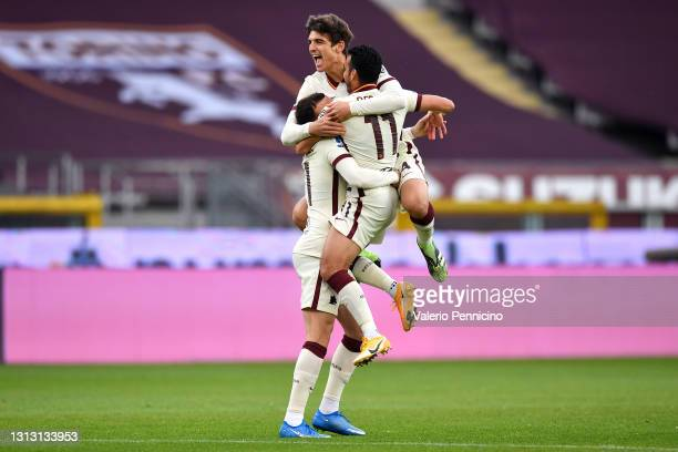 Borja Mayoral of Roma celebrates with teammates Pedro and Gonzalo Villar after scoring their team's first goal during the Serie A match between...