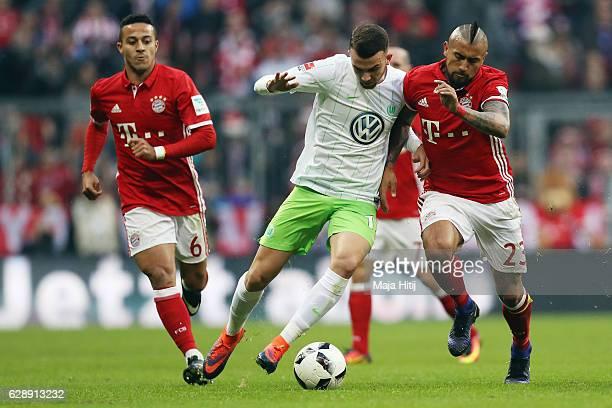 Borja Mayoral of Wolfsburg is challenged by Arturo Vidal of Muenchen during the Bundesliga match between Bayern Muenchen and VfL Wolfsburg at Allianz...