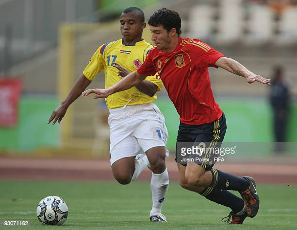 Borja of Spain and Alvaro Hungria of Colombia battle for the ball during the FIFA U17 World Cup 3rd/4th Play off match between Colombia and Spain at...