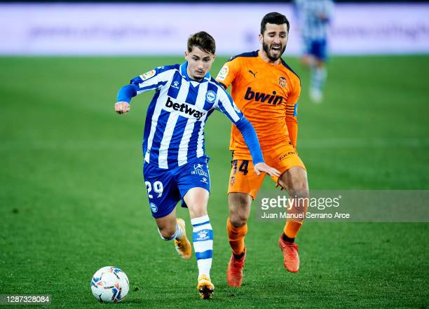Borja Sainz of Deportivo Alaves duels for the ball with Jose Gaya of Valencia CF during the LaLiga Santander match between Alaves and Valencia on...