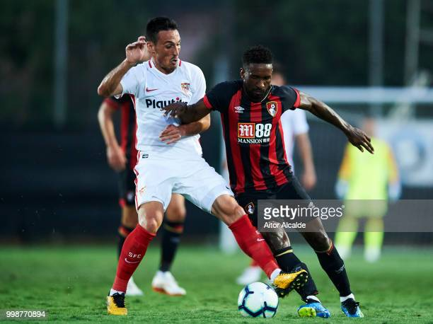 Borja San Emeterio of Sevilla FC duels for the ball with Jermain Defoe of AFC Bournemouth during the Pre Season friendly match between Sevilla FC and...