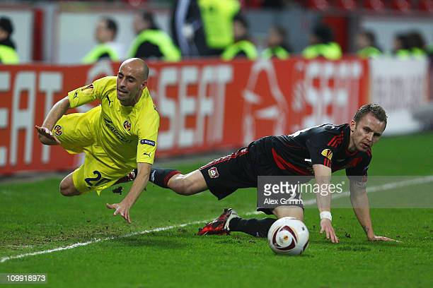 Borja Valero 8l9 of Villarreal is challenged by Michal Kadlec of Leverkusen during the UEFA Europa League round of 16 first leg match between Bayer...