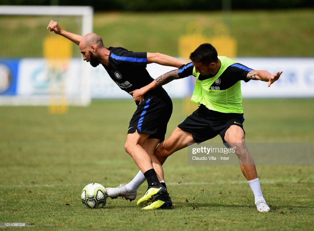 Borja Valero (L) and Matias Vecino of FC Internazionale compete for the ball during the FC Internazionale training session at the club's training ground Suning Training Center in memory of Angelo Moratti at Appiano Gentile on August 10, 2018 in Como, Italy.
