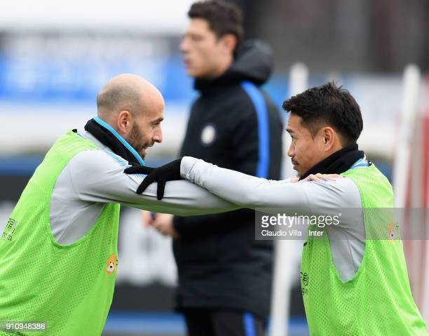 Borja Valero and Yuto Nagatomo of FC Internazionale chat during a FC Internazionale training session at Suning Training Center at Appiano Gentile on...