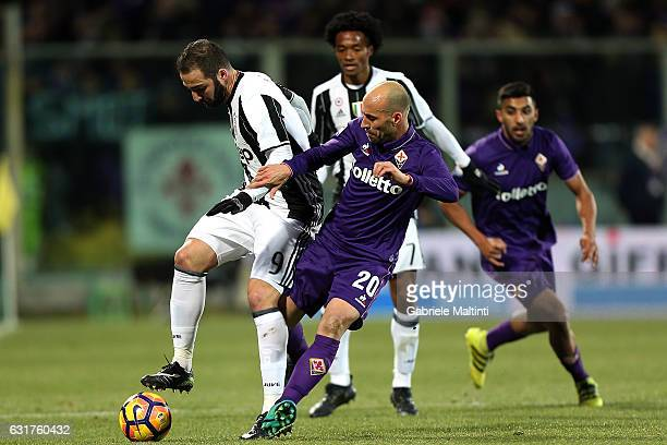 Borja Valero of ACF Fiorentina battles for the ball with Gonzalo Higuain of Juventus FC during the Serie A match between ACF Fiorentina and Juventus...
