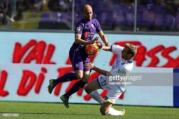 Borja Valero of ACF Fiorentina battles for the ball with Matteo Ciofani of Frosinone Calcio during the Serie A match between ACF Fiorentina and...