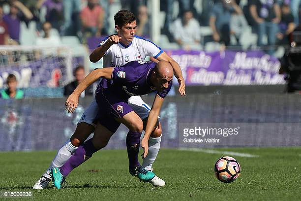 Borja Valero of ACF Fiorentina battles for the ball with Mattia Caldara of Atalanta BC during the Serie A match between ACF Fiorentina and Atalanta...