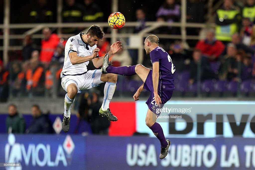 Borja Valero of ACF Fiorentina battles for the ball with Wesley Hoedt of SS Lazio during the Serie A match between ACF Fiorentina and SS Lazio at Stadio Artemio Franchi on January 9, 2016 in Florence, Italy.