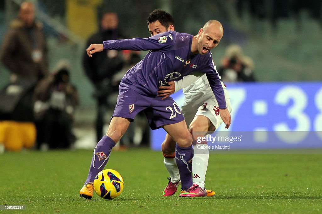 Borja Valero of ACF Fiorentina fights for the ball with Ivan Piris of AS Roma during the TIM cup match between ACF Fiorentina and AS Roma at Artemio Franchi on January 16, 2013 in Florence, Italy.