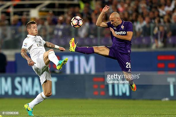Borja Valero of ACF Fiorentina fights for the ball with Juraj Kucka of AC Milan during the Serie A match between ACF Fiorentina and AC Milan at...