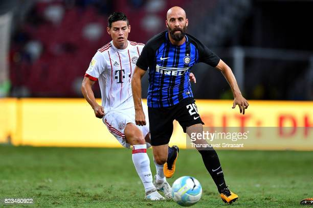 Borja Valero of FC Interernazionale and James Rodriguez of FC Bayern Muenchen competes for the ball during the International Champions Cup match...