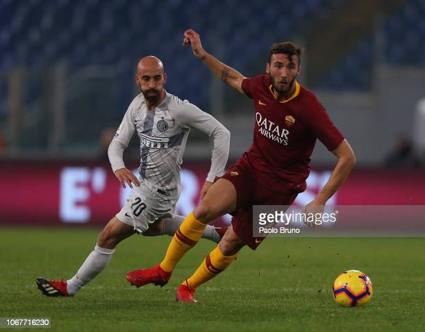 Borja Valero of FC Internazionale competes for the ball with Bryan Cristante of AS Roma during the Serie A match between AS Roma and FC...