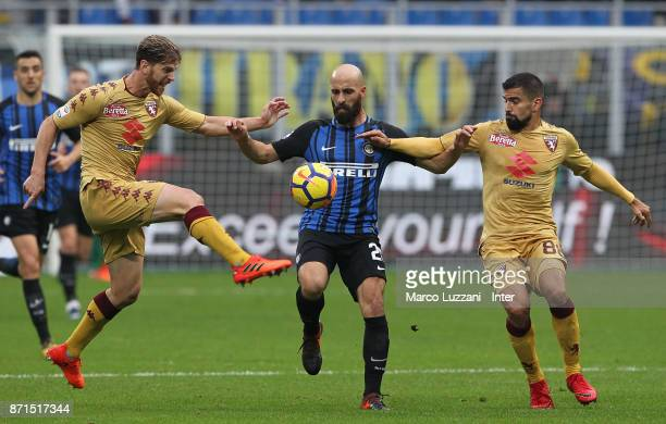 Borja Valero of FC Internazionale is challenged by Cristian Ansaldi and Tomas Rincon of Torino FC during the Serie A match between FC Internazionale...