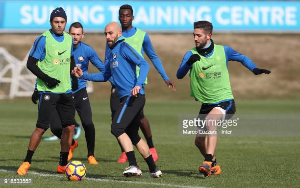 Borja Valero of FC Internazionale is challenged by Roberto Gagliardini during the FC Internazionale training session at the club's training ground...