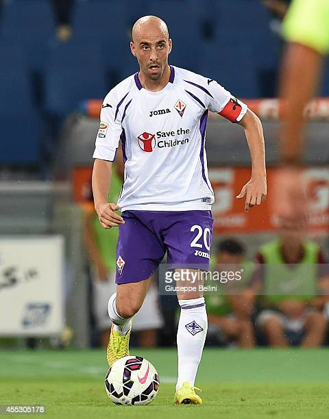 Borja Valero of Fiorentina in action during the Serie A match between AS Roma and ACF Fiorentina at Stadio Olimpico on August 30 2014 in Rome Italy