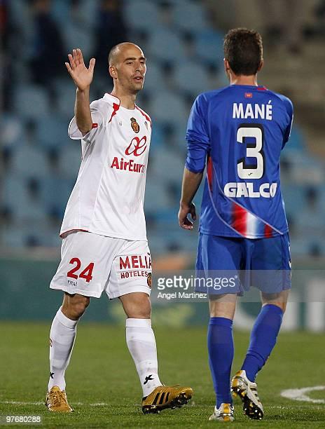 Borja Valero of Getafe and Mane Jimenez of Getafe greet each other after the La Liga match betwenn Getafe and Mallorca at Coliseum Alfonso Perez on...