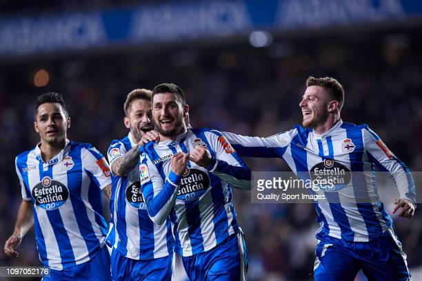 Borja Valle of Deportivo de La Coruna celebrates with team mates after scoring his team's second goal during the La Liga 123 match between Deportivo...