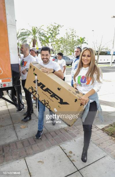 Borja Voces and Jackie Guerrido volunteer at Amigos For Kids 27th Annual Holiday Toy Drive on December 16 2018 in Miami Florida