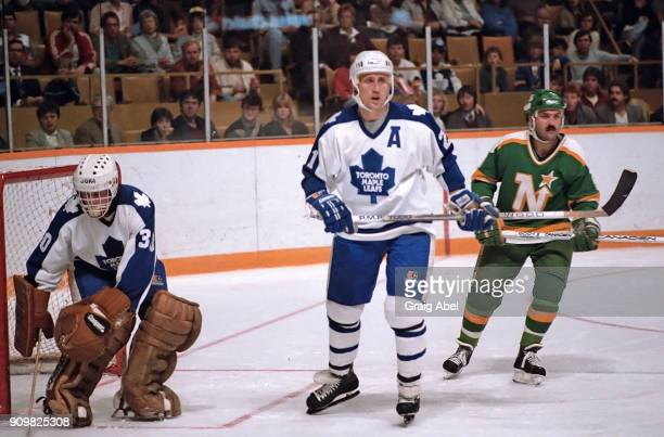 Borje Salming and Don Edwards of the Toronto Maple skate against Dennis Maruk of the Minnesota North Stars during game action on October 26 1985 at...